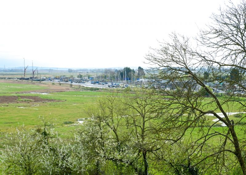 The churchyard looks out over Oare Creek