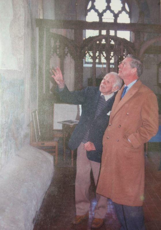 John Ward showing his mural to Prince Charles