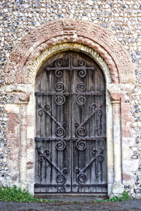 the Norman west door of Throwley church