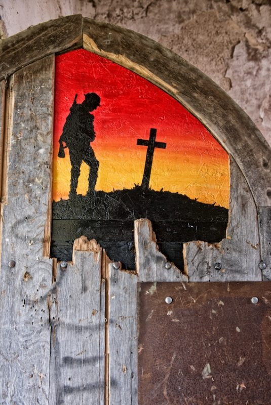 A haunting image of the First World War painted by Sioux Peto on the door of the church