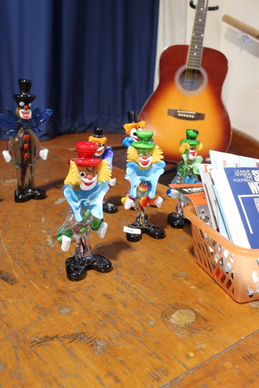 glass figures and a guitar at Swale Auctions