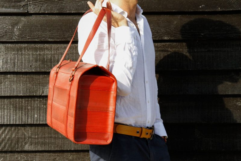 Overnight bag from redundant fireman hose £260 by Elvis & Kresse