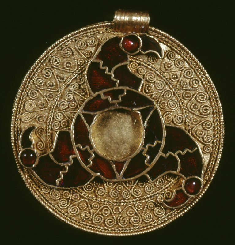 Pendant from King's Field, Faversham (early 600s AD), with gold filigree and polished garnets (British Museum)