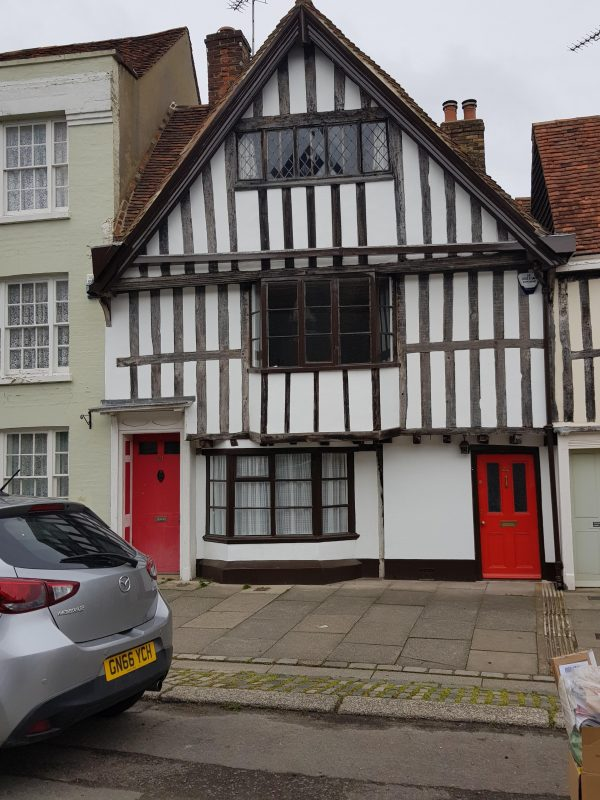 Early 16th century house in Abbey Street with windows altered in the 19th century.