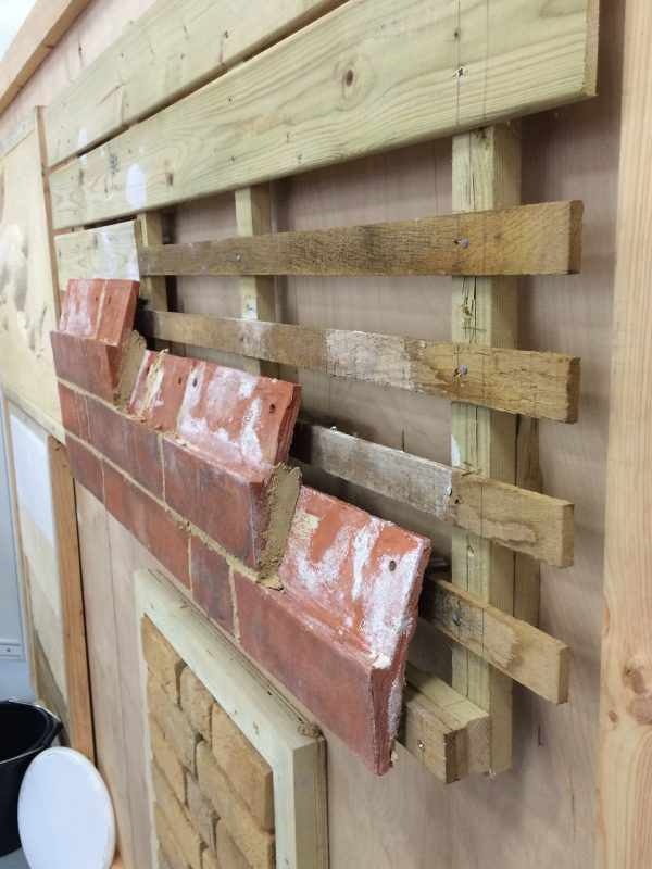 Mathematical tiles are fixed and bedded onto timber framing to create the convincing appearance of brickwork